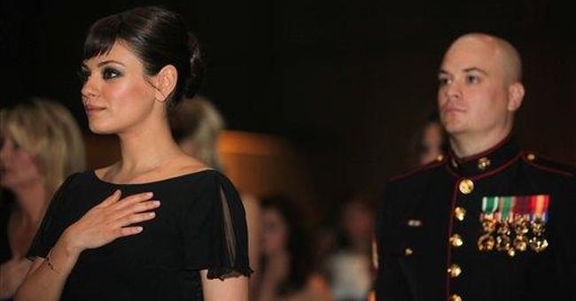 Mila Kunis keeps promise to be Marine's date