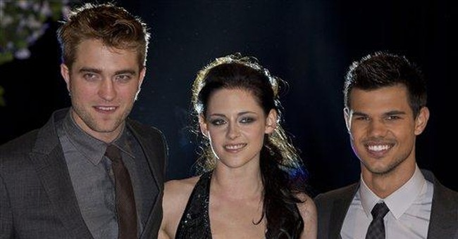 'Breaking Dawn' lures packs of fans with $138.1M