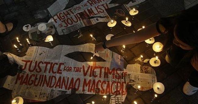 Philippine massacre victims' kin sue ex-president