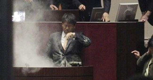 Tear gas, scuffles as SKorea OKs US trade deal