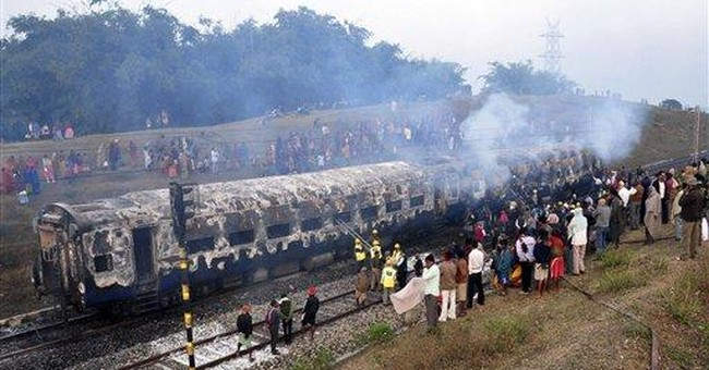 India investigates train fire that killed 7