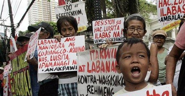 Philippine court orders Aquino kin to give up land