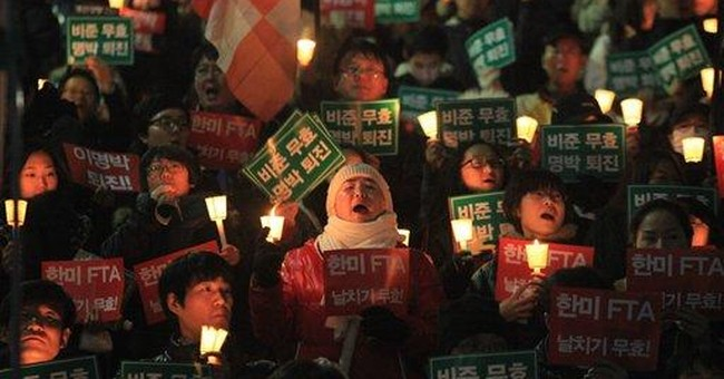 SKorean police: US trade deal rally turns violent