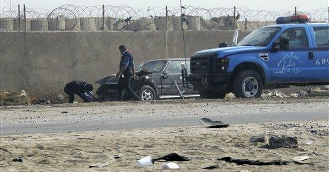Suicide car bomber kills 19 outside prison in Iraq