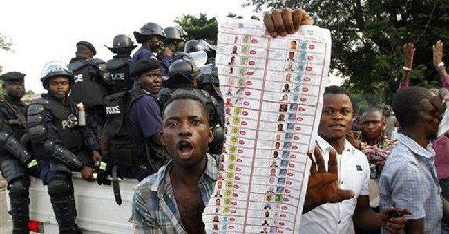 Officials extend voting to 2nd day in Congo