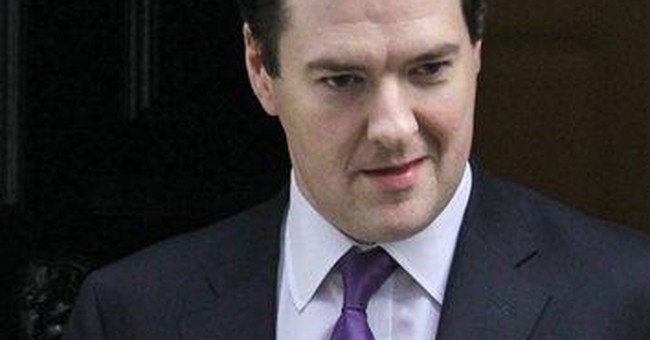 Britain blames euro crisis for lower growth