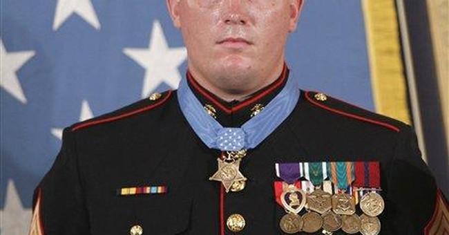 Medal of Honor recipient sues defense contractor