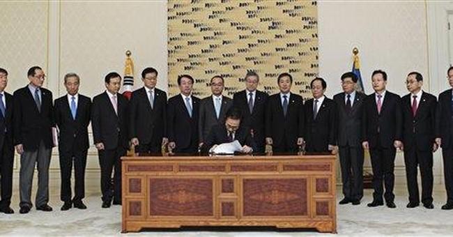 SKorea president signs laws enabling US trade deal
