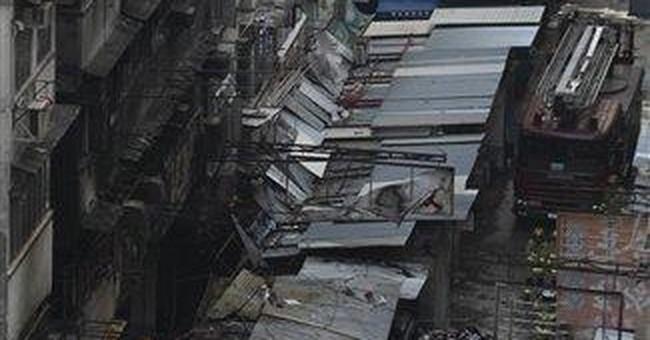Fire in crowded Hong Kong neighborhood kills 9