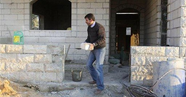 Released Palestinians build houses, marry, study