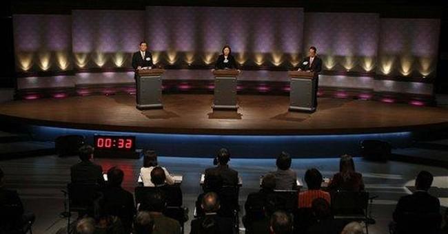 Taiwan presidential candidates joust in debate