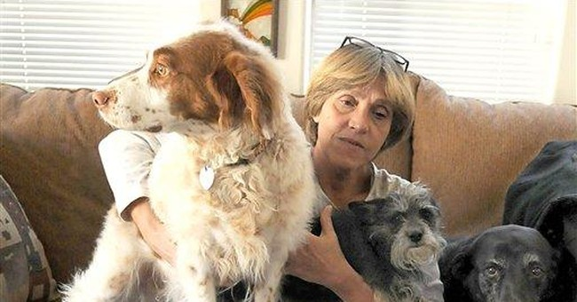 Reno airport worker gets job back after dog fiasco