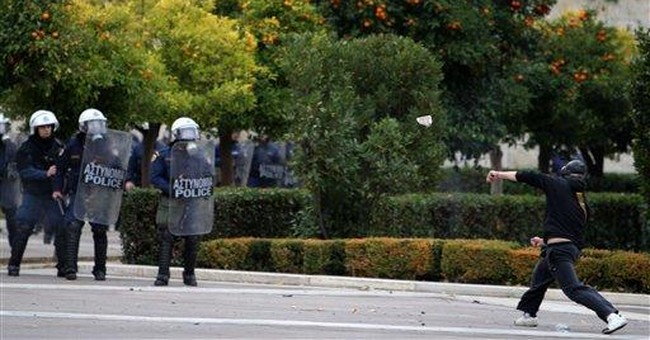 Greek students in clashes on shooting anniversary