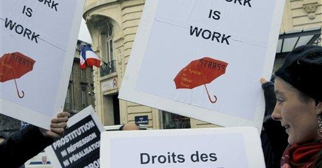 French lawmakers may punish prostitutes' clients