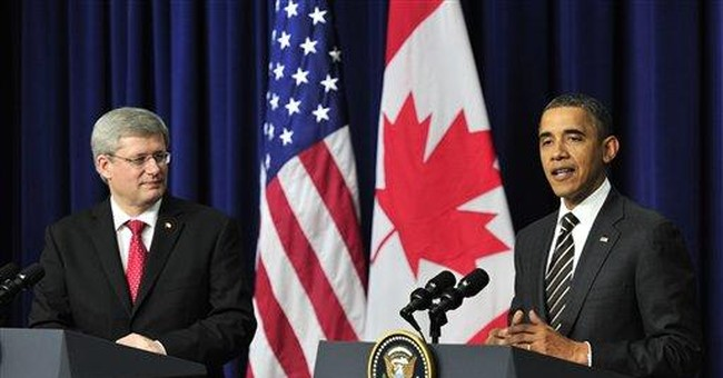 Obama, Harper show no budge on pipeline dispute
