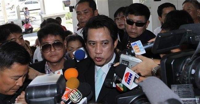 Fugitive 'Red Shirt' leader surrenders in Thailand