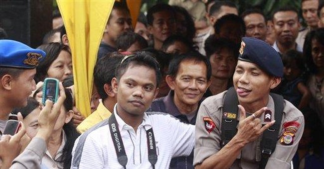 Lip-synching Indonesia cop fired amid YouTube fame