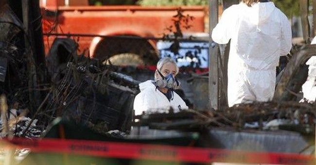 Police find 2 bodies in burned-out Wash. home