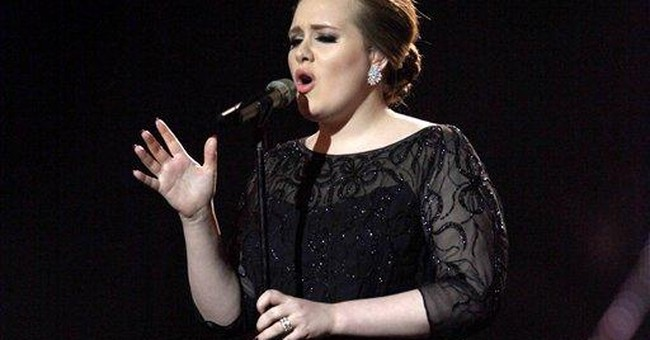 Adele tops iTunes song, album charts on 2011 sales