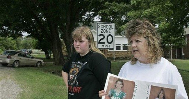 Okla. authorities charge man in deaths of 2 girls