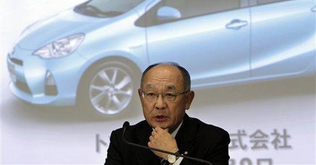 Toyota cuts profit outlook, Thai floods take toll