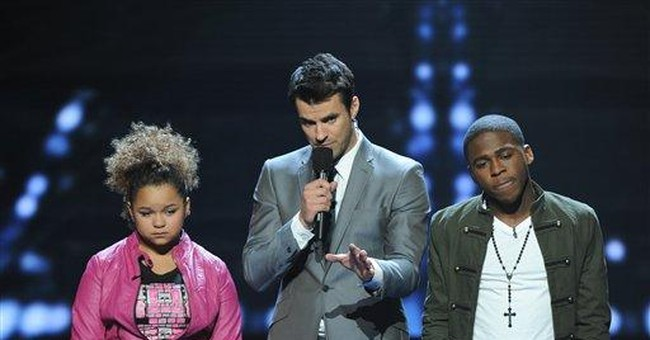 An 'X Factor' judge chooses by refusing to choose
