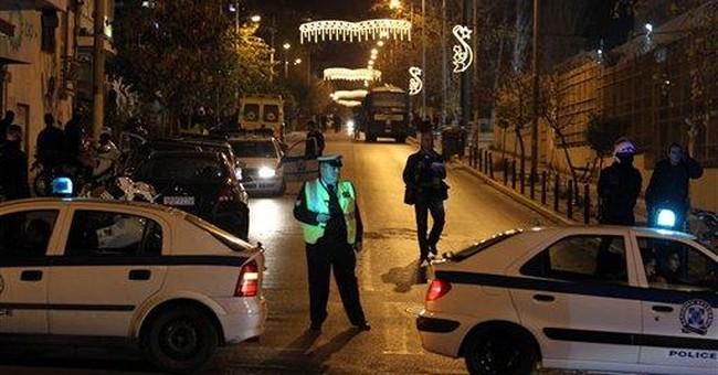 Greek jail inmates surrender, release hostages