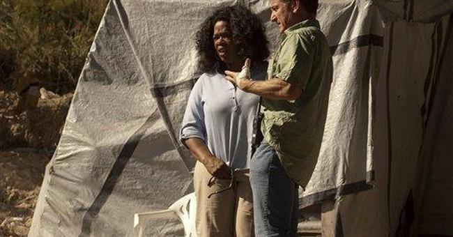 Oprah Winfrey visits Haiti under tight security