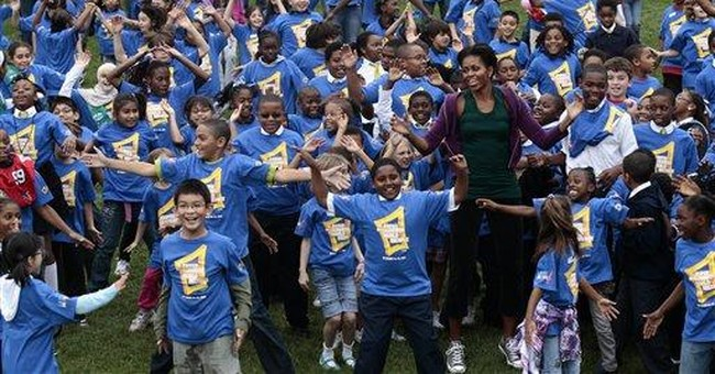 Michelle Obama breaks jumping jacks record
