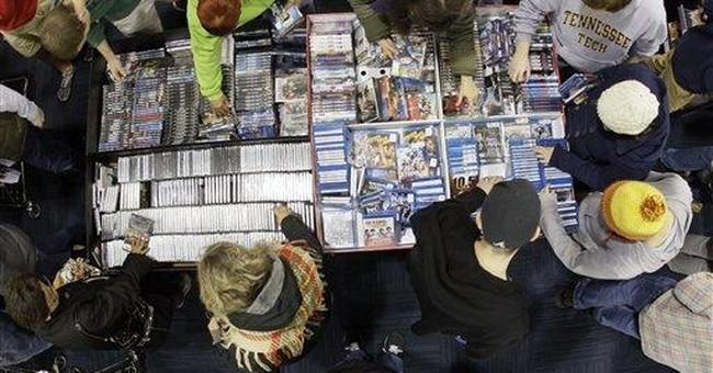 Best Buy 3rd-quarter profit falls, shares skid