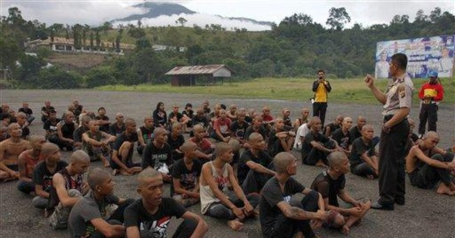 Hard-line Indonesian police shave punkers' mohawks