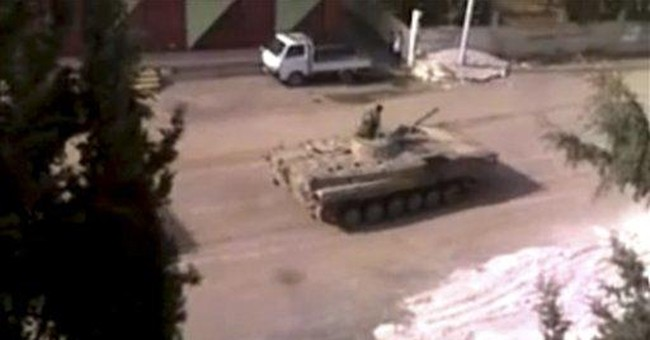 Syrian rebels kill 27 troops, Canadians told to go