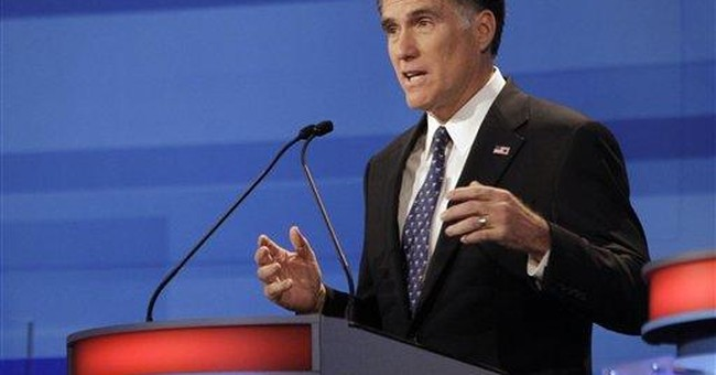 Romney defends time in business world