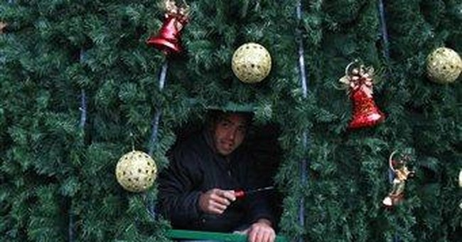 Palestinians light Christmas tree in Bethlehem