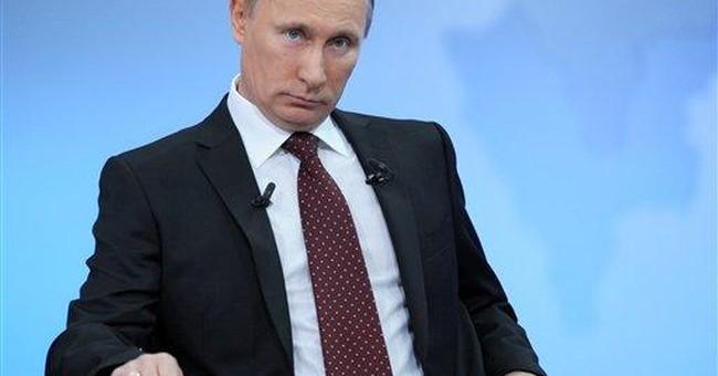 Putin denounces protesters, rejects rerun of vote