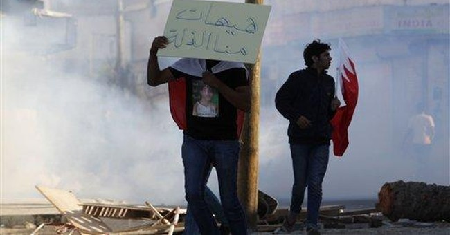 Bahrain police crack down on highway protest