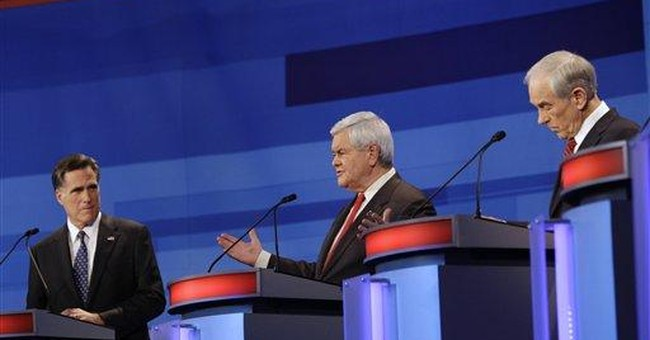 Gingrich assailed by debate rivals, fights back