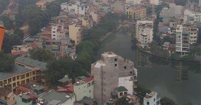 Hanoi office tower fire spreads smoke around city