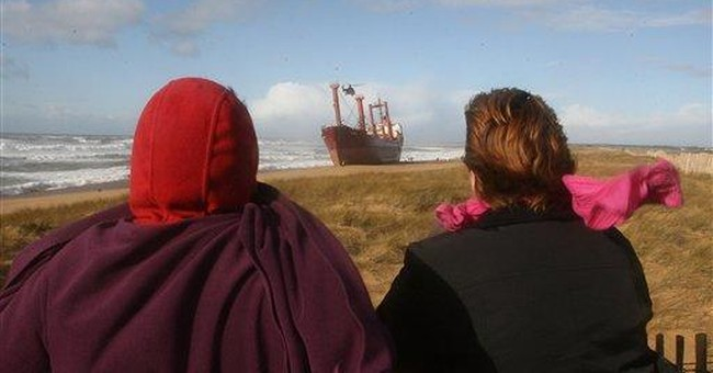 Fuel leaks off cargo ship beached off French coast