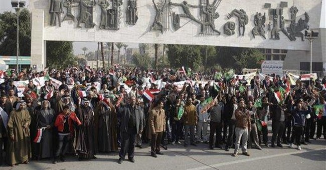 Hundreds rally in Baghdad against Iranian exiles