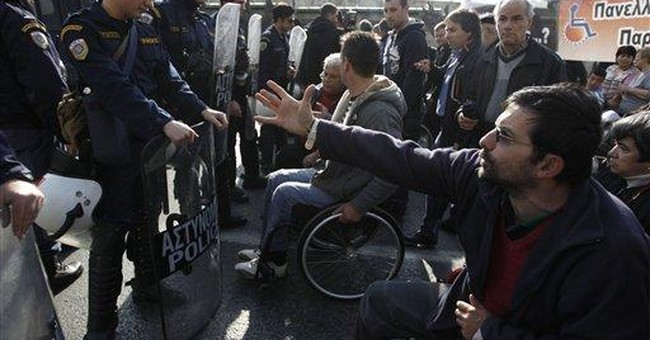 As Greece slashes costs, the deaf left unaided