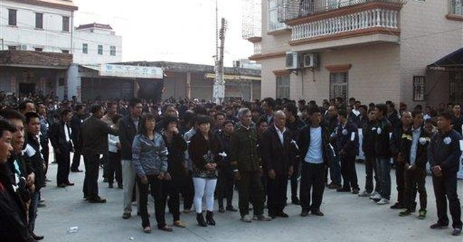 Chinese villagers under siege mourn man who died