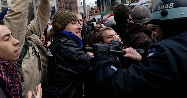 NYC protesters scale fence at vacant lot