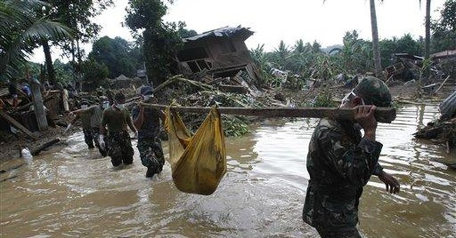 With morgues full, Philippine flood victims buried