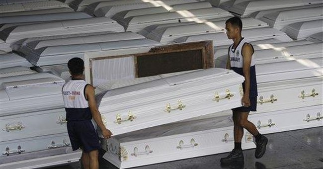 Philippines sends coffins as toll nears 1,000 dead