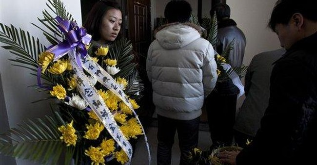 Kim Jong Il body displayed, NKorea media hail son