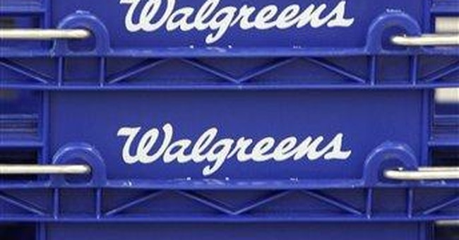 Walgreen 1Q profit drops on Express Scripts fight