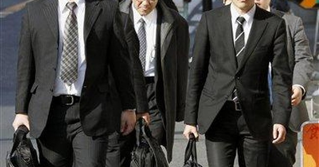 Japan prosecutors raid Olympus, former exec's home