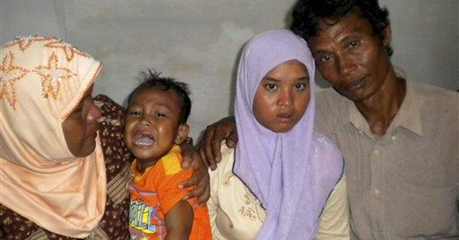 Indonesia girl back with family after 2004 tsunami