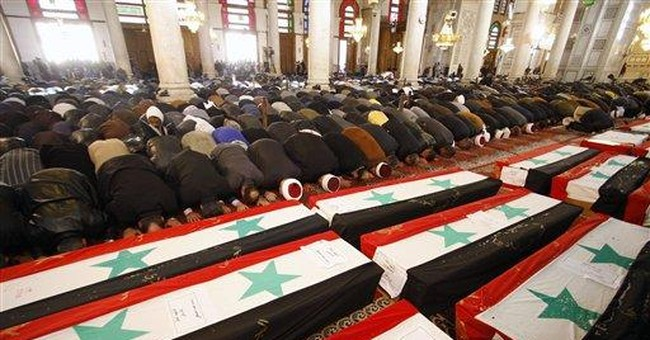 Thousands attend funerals for Syrian bomb victims